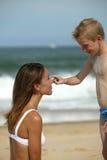Muchacho con la madre en la playa Imagen de archivo libre de regalías