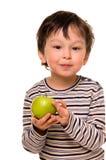 Muchacho con la manzana. foto de archivo