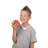 Muchacho con la manzana a disposición Foto de archivo libre de regalías