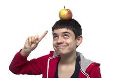 Muchacho con la manzana en la cabeza Fotos de archivo libres de regalías