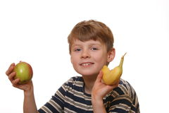 Muchacho con la manzana y el plátano Imagen de archivo
