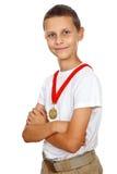 Muchacho con la medalla de oro Fotografía de archivo libre de regalías