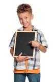 Muchacho con la pequeña pizarra Foto de archivo libre de regalías