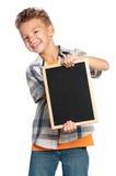 Muchacho con la pequeña pizarra Imagen de archivo libre de regalías