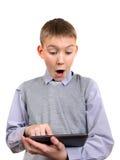 Muchacho con la tableta Fotografía de archivo libre de regalías