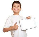 Muchacho con la tableta del ordenador Imagenes de archivo