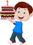 Muchacho con la torta de cumpleaños Fotografía de archivo libre de regalías