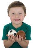 Muchacho con las bolas del deporte Imagen de archivo libre de regalías