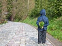 Muchacho con las flores Imagen de archivo