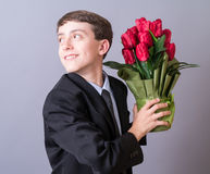 Muchacho con las flores Foto de archivo