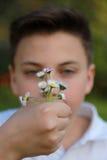 Muchacho con las flores Imagen de archivo libre de regalías