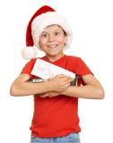 Muchacho con las galletas para santa, concepto de la Navidad de las vacaciones de invierno Fotografía de archivo libre de regalías