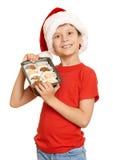 Muchacho con las galletas para santa, concepto de la Navidad de las vacaciones de invierno Imagen de archivo libre de regalías