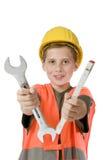 Muchacho con las herramientas de tenencia del casco Fotografía de archivo