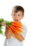 Muchacho con las zanahorias Foto de archivo libre de regalías
