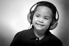 Muchacho con los auriculares Fotografía de archivo libre de regalías