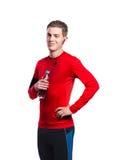 Muchacho con los auriculares y la botella de agua en camiseta roja Aislado Imágenes de archivo libres de regalías