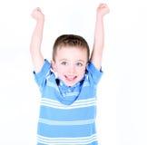 muchacho con los brazos para arriba en animar del aire Imagen de archivo