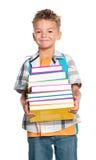 Muchacho con los libros Imágenes de archivo libres de regalías