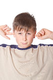 Muchacho con los oídos cerrados Imagen de archivo libre de regalías