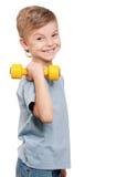 Muchacho con pesas de gimnasia Fotos de archivo libres de regalías