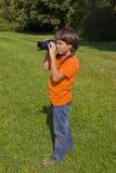 Muchacho con photocamera Imagen de archivo