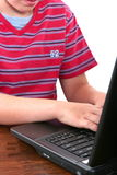Muchacho con su computadora portátil Imágenes de archivo libres de regalías