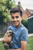 Muchacho con su conejo Fotos de archivo