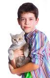 Muchacho con su gato Fotografía de archivo