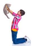 Muchacho con su gato Foto de archivo libre de regalías