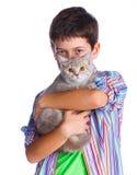 Muchacho con su gato Imagenes de archivo