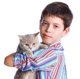 Muchacho con su gato Foto de archivo