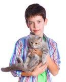 Muchacho con su gato Fotos de archivo libres de regalías