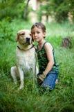 Muchacho con su perro Fotos de archivo