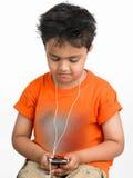 Muchacho con su teléfono celular Foto de archivo libre de regalías