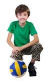 Muchacho con un balón de fútbol, aislado. Imagenes de archivo