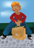 Muchacho con un bolso Imagen de archivo libre de regalías