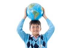 Muchacho con un globo del mundo Fotografía de archivo libre de regalías