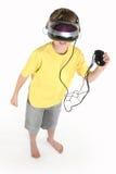 Muchacho con un juego de la realidad virtual Fotografía de archivo