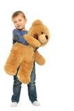 muchacho con un oso de peluche Imágenes de archivo libres de regalías