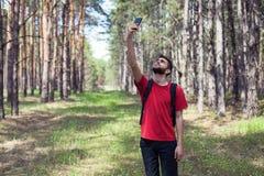 Muchacho con un teléfono Foto de archivo libre de regalías
