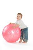 Muchacho con una bola de la aptitud Fotografía de archivo