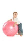 Muchacho con una bola de la aptitud Imagen de archivo libre de regalías