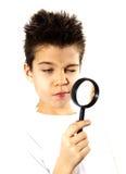 Muchacho con una lente Fotos de archivo