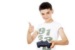 Muchacho con una palanca de mando Imagen de archivo