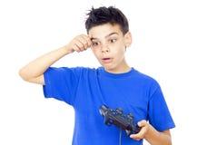 Muchacho con una palanca de mando Imagen de archivo libre de regalías