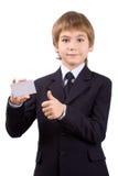 Muchacho con una tarjeta plástica, aislada Imagen de archivo libre de regalías