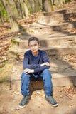 Muchacho confiado fresco en un bosque Fotos de archivo libres de regalías