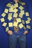 Muchacho cubierto con las notas pegajosas. Fotografía de archivo libre de regalías