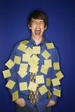 Muchacho cubierto con las notas pegajosas. Fotos de archivo libres de regalías